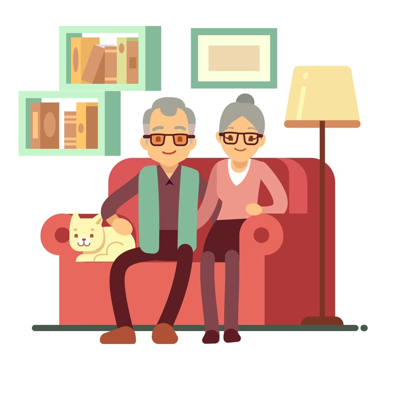 Old happy family - husband and wife on sofa at home.